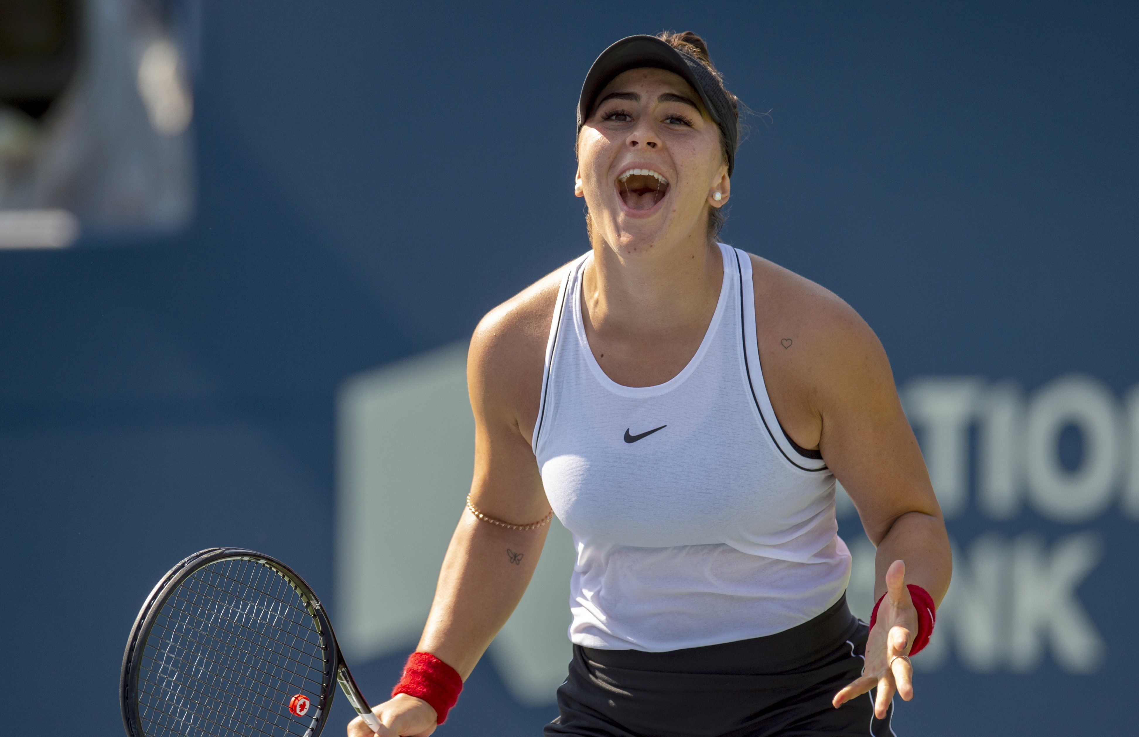 Bianca celebrates during a match at the Rogers Cup.