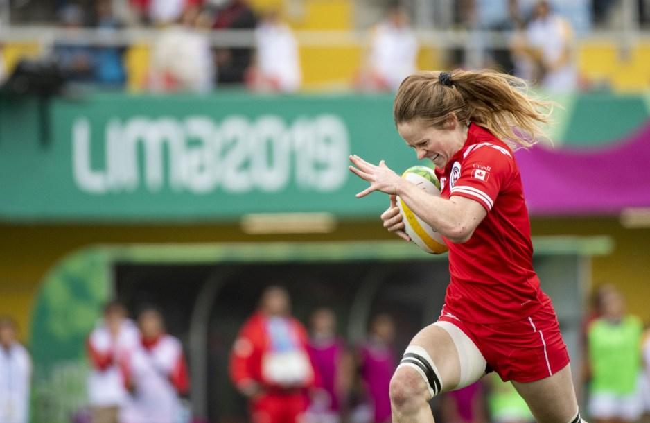 Emma Chown of Canada runs the ball