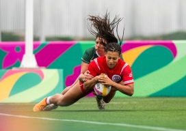 Olivia De Couvreur dives for the ball