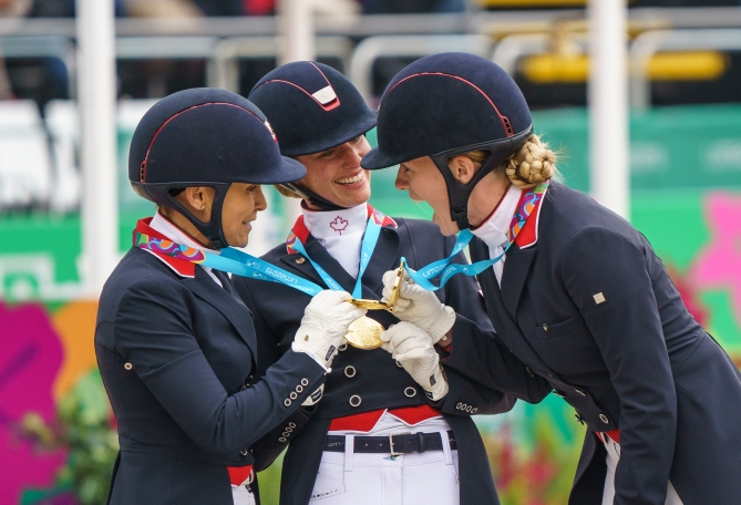 Jill Irving, Lindsay Kellock and Tina Irwin hold medals together