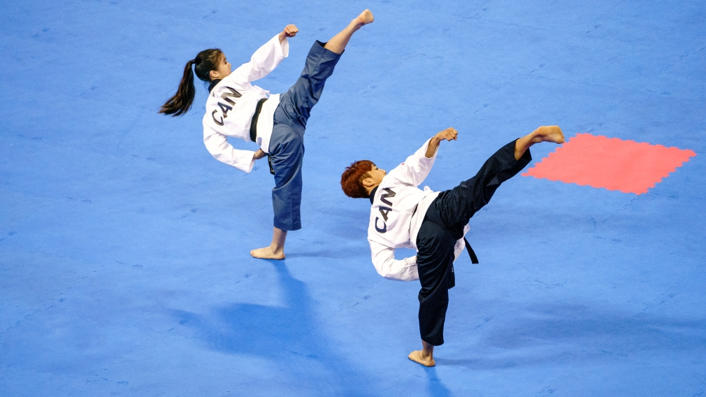 Jinsu Ha and Michelle Lee perform routine
