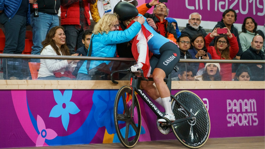 Cyclist hugs people in crowd