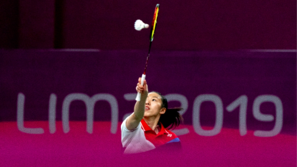 Badminton player hitting shuttlecock