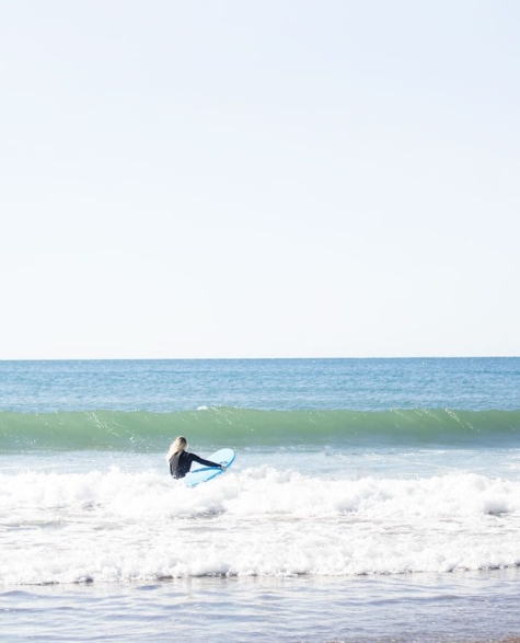 Surfer about to find a wave