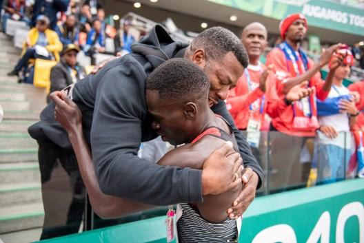 Marco Arop hugs his coach