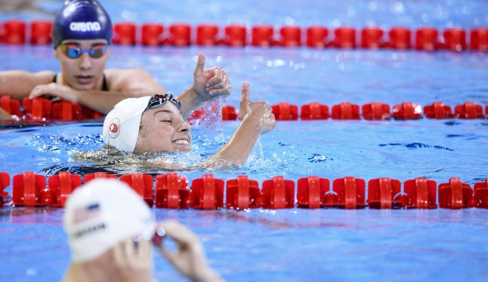 swimmer gives thumbs up in the water