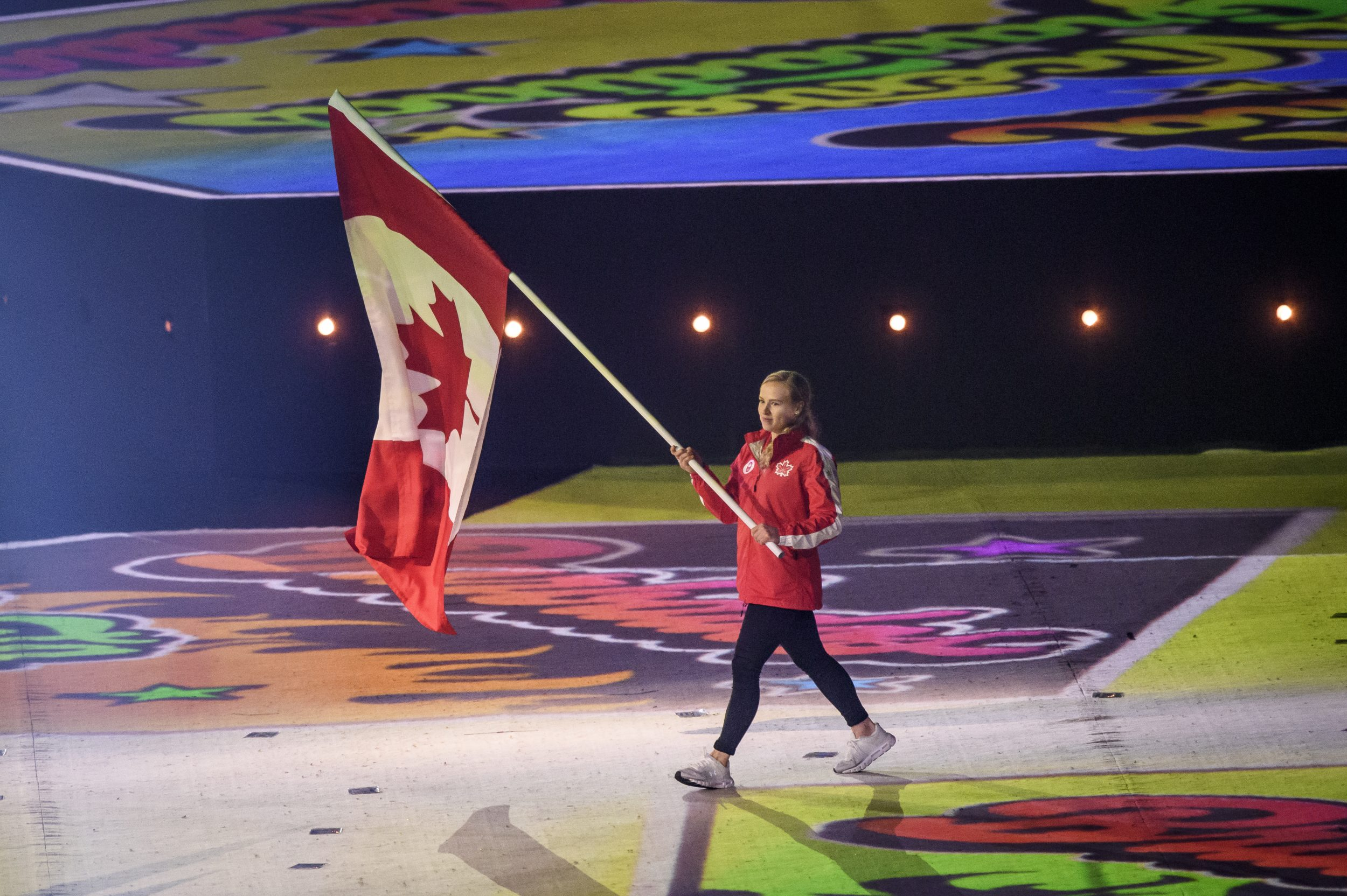 ellie black carrying the canadian flag