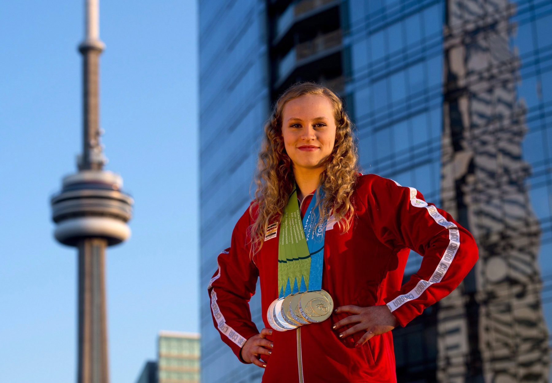 Ellie Black on a Toronto rooftop with her five Pan Am Games medals in 2015