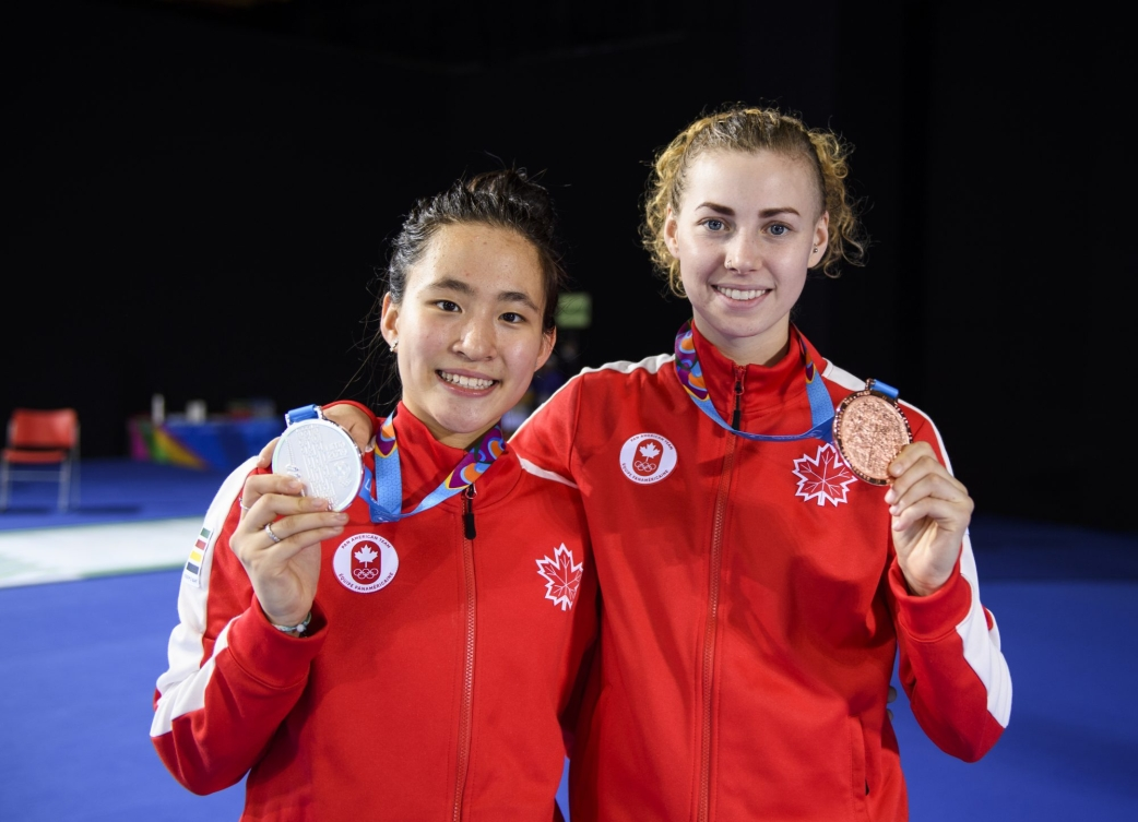 Jessica (left) and Eleanor hold up their gold and bronze medals