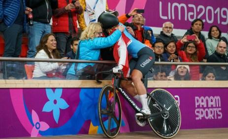 Kelsey hugs her parents after winning Lima 2019 gold