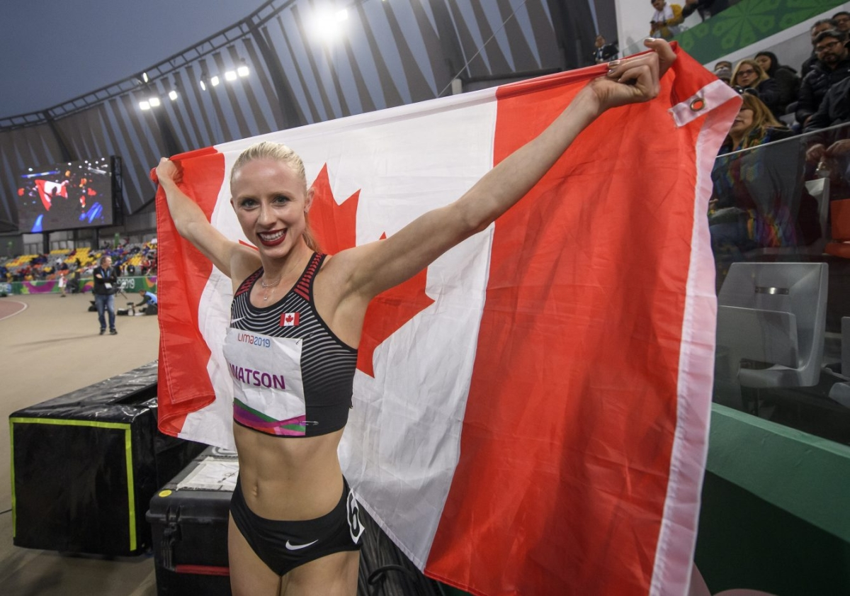 Sage Watson holding the Canadian flag after winning Lima 2019 gold