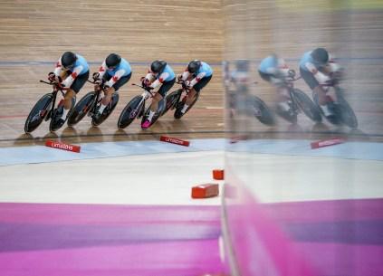 four cyclists on a track