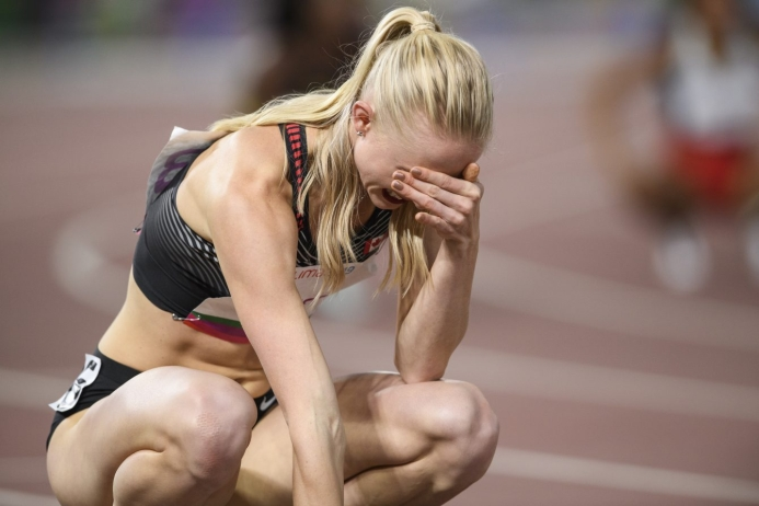 Watson crouches and cover her face after hearing she was disqualified