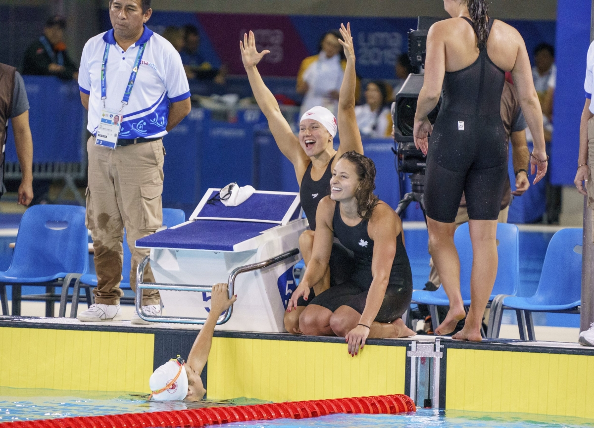 four swimmers celebrate