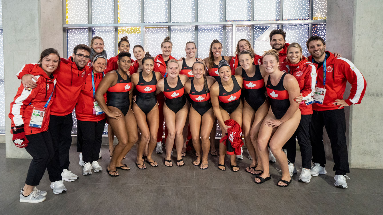 Women's water polo poses after qualifying for Tokyo 2020