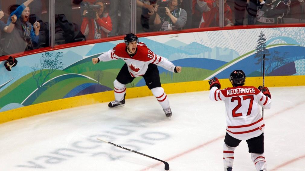 Sidney Crosby celebrates with Scott Niedermayer