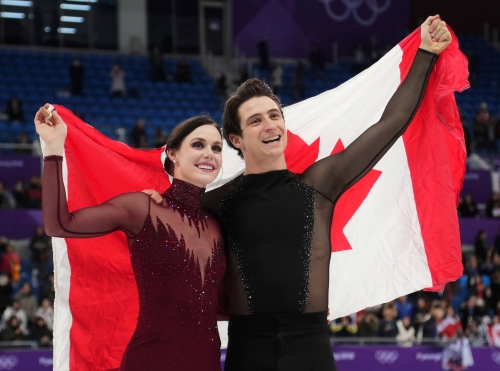 Tessa Virtue and Scott Moir of Canada celebrate