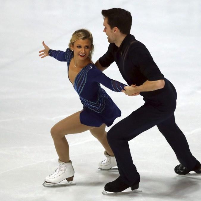 Kirsten Moore-Towers and Michael Marinaro of Canada skating