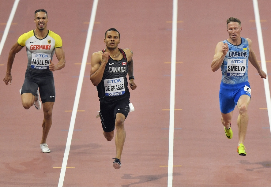 Steven Müller, of Germany, Andre De Grasse, of Canada, and Serhiy Smelyk, of Ukraine, from left to right, compete in the men's 200 meter