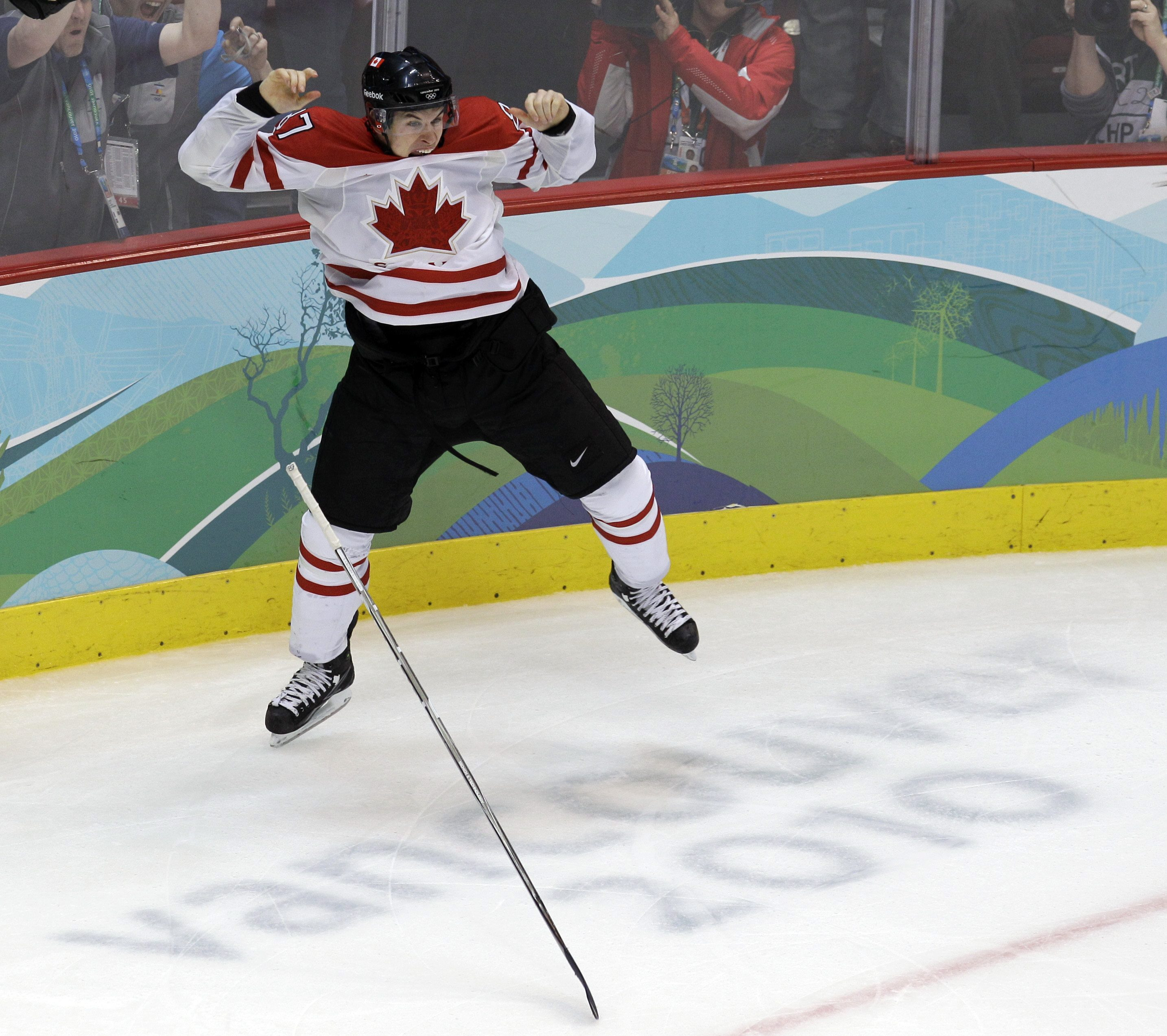 Sidney Crosby's hockey stick falls to the ground as he celebrates his winning goal at the Vancouver 2010 Olympics.
