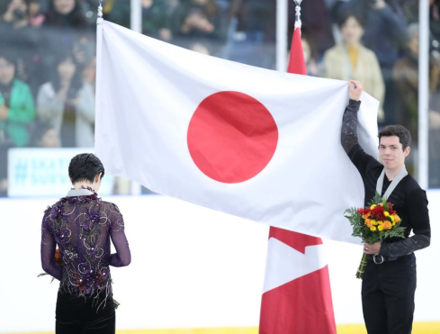 Keegan Messing holds Japanese flag for opponent