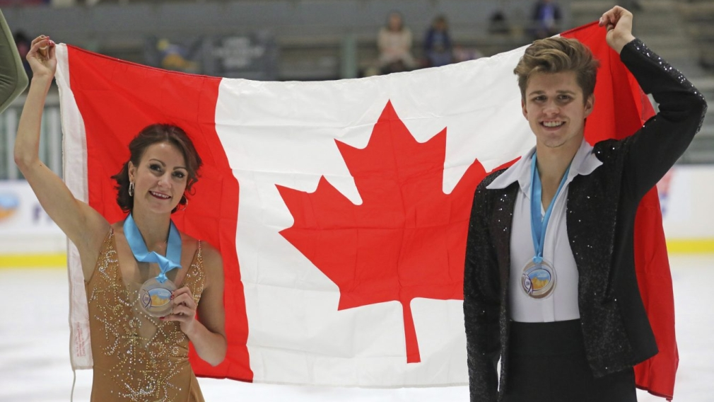 Third-place finishers Carolane Soucisse and Shane Firus, of Canada, celebrate following the free dance competition
