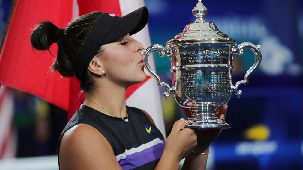 Bianca Andreescu, of Canada, kisses the championship trophy