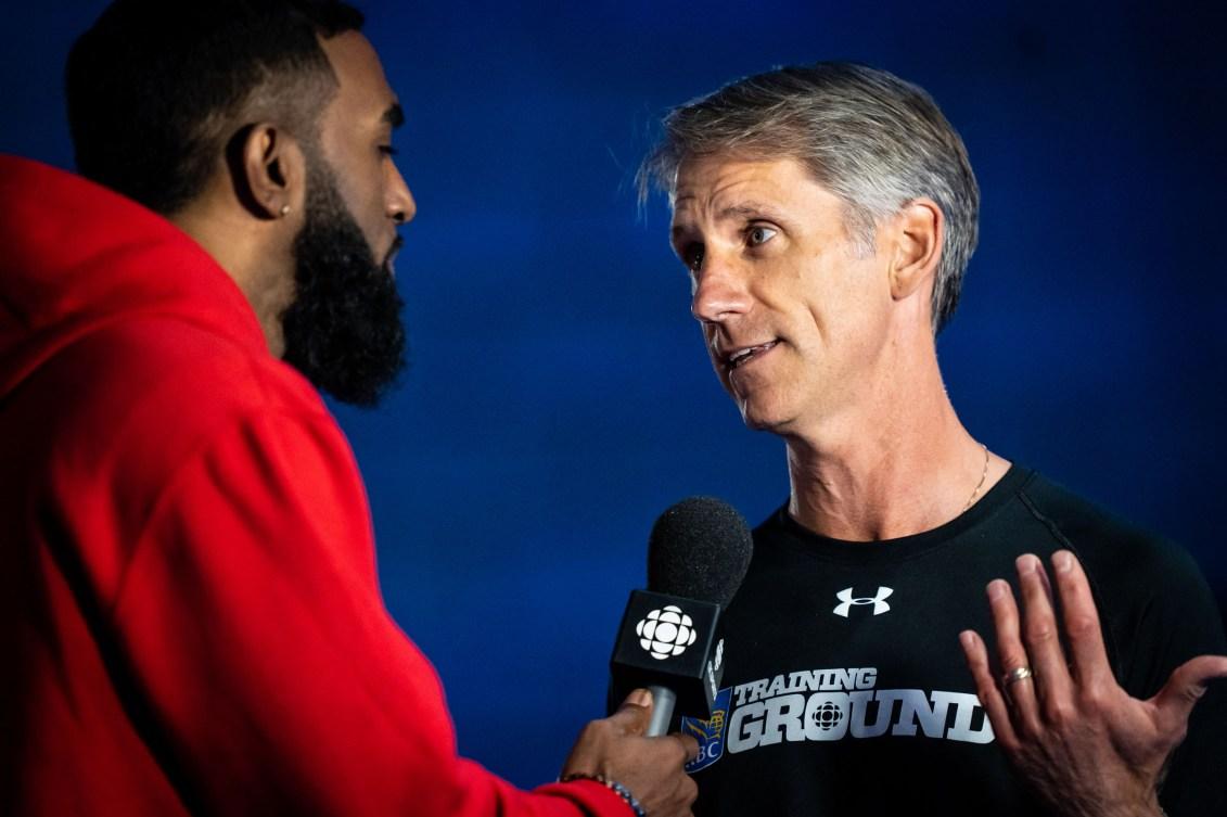 Anson Henry (left) interviews Kurt Innes.