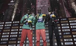 Muktar Edris (centre), Selemon Barega (left), and Mohammed Ahmed (right) receive their medals.