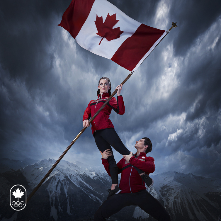 Tessa Virtue and Scott Moir pose with Canadian flag