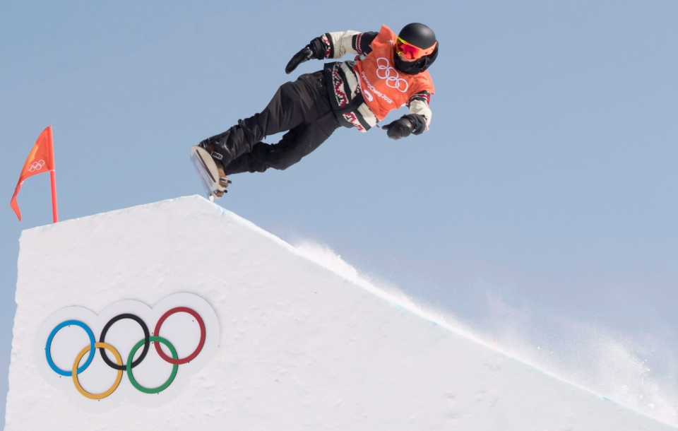 Canadian freestyle snowboarder Mark McMorris flies through the air