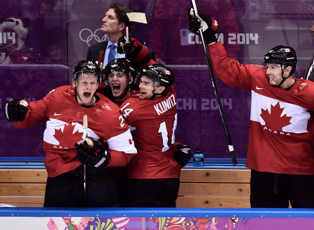 Team Canada's Olympic 2014 hockey team cheers on the bench.