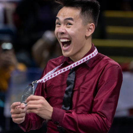 Nam Nguyen smiles as he holds his silver medal