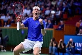Denis Shapovalov celebrates winning the Stockholm Open.