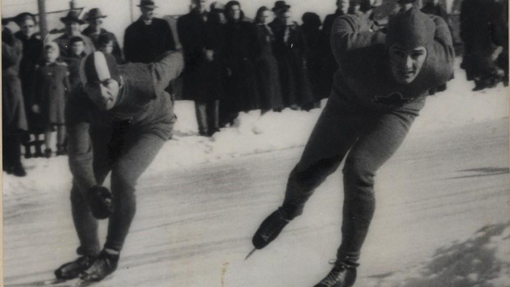 Gordon Audley, right, skates alongside Canadian teammate Frank Stack