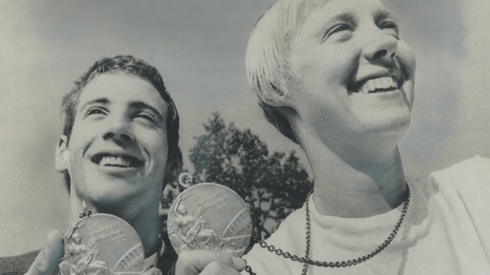 Leslie Cliff, right, holding her Olympic silver medal