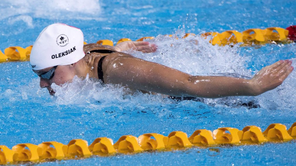 Canada's Penny Oleksiak swims to a second place finish in her semifinal for the women's 11m butterfly during swimming finals at the Commonwealth Games