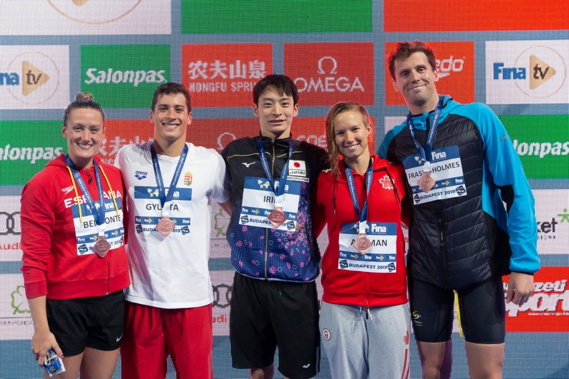 Aly Ackman (second from right) poses with other bronze medallists.