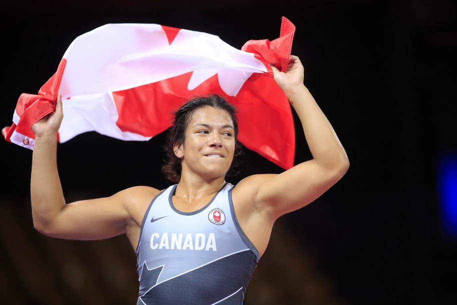 Justina holds the Canadian flag above her head.