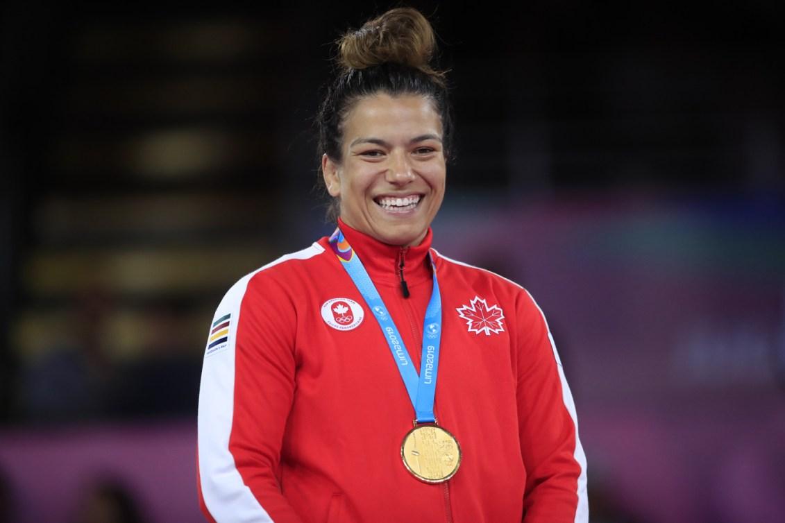 Justina Di Stasio wearing her gold medal.