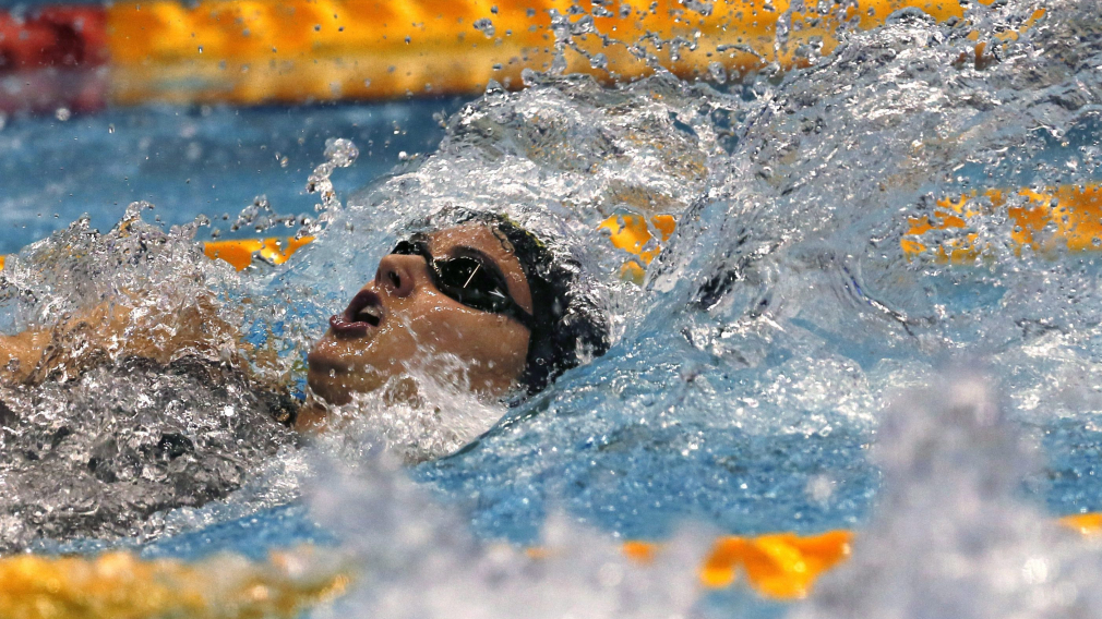 Canada's Kylie Masse swims on her way to winning the women's 100m backstroke final during the Pan Pacific swimming championships in Tokyo