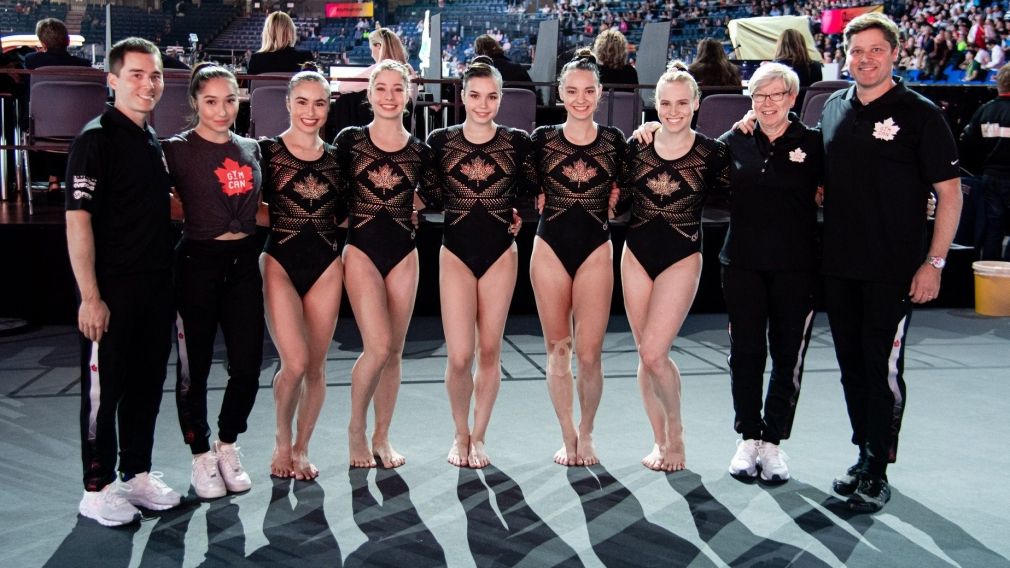 Women's Artistic Gymnastics team poses for a photo.