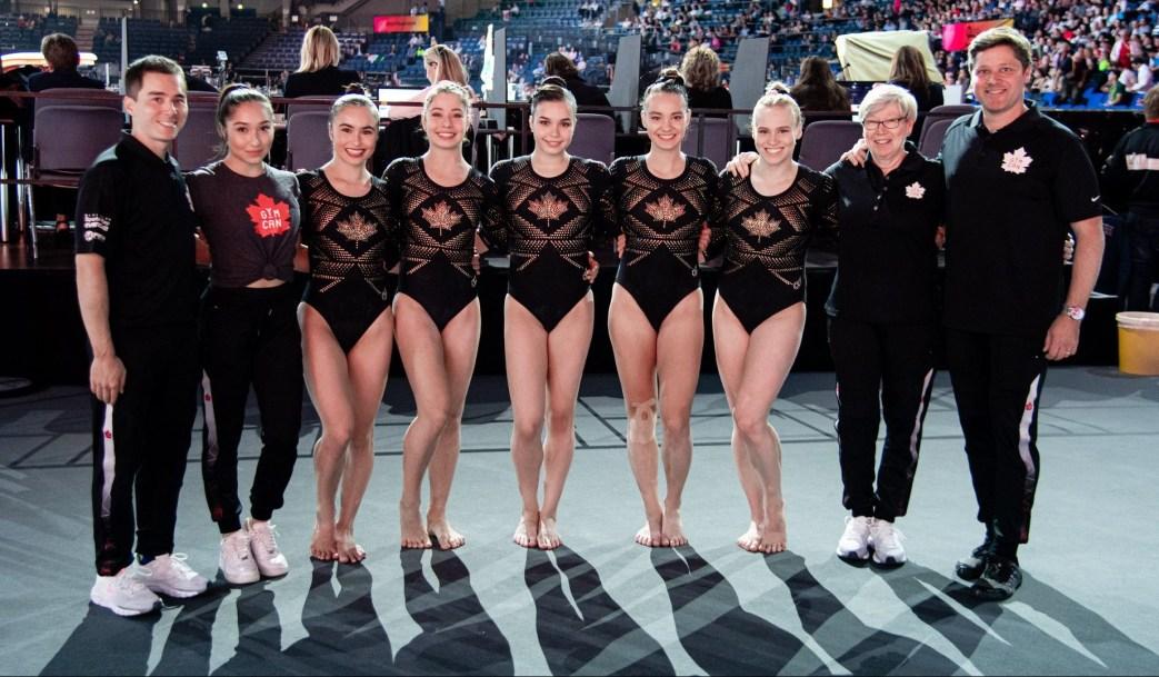 Women's Artistic Gymnastics team poses for a photo.