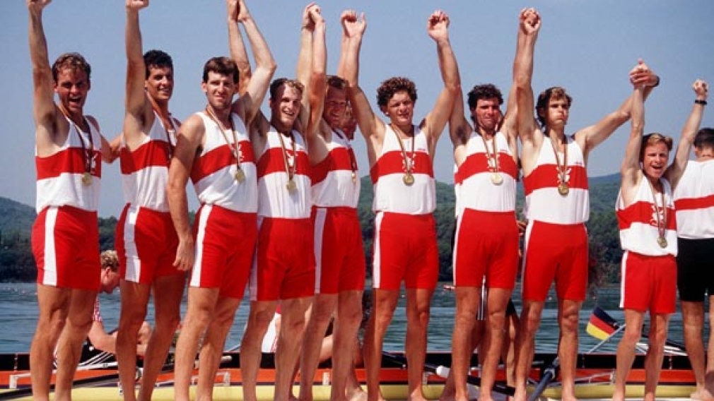 Terry Paul, far right, celebrates a gold medal win with his 8+ rowing team at Barcelona 1992
