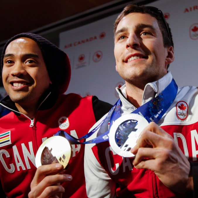Denny Morrison, right, and Gilmore Junio arrive home from the Sochi Olympics in Calgary