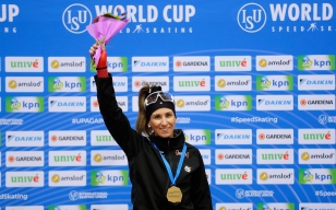 Canada's Ivanie Blondin celebrates on the podium after winning the women's mass start race of the speed skating World Cup at the Minsk ice arena in Minsk, Belarus, Sunday, Nov. 17, 2019. (AP Photo/Sergei Grits)