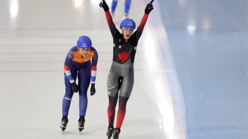 Canada's Ivanie Blondin, bottom right, celebrates after winning the women's mass start race as she followed by second placed Irene Schouten, of the Netherlands, during the speed skating World Cup at the Minsk ice arena in Minsk, Belarus, Sunday, Nov. 17, 2019. (AP Photo/Sergei Grits)