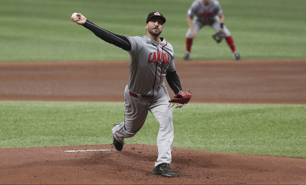 Phillippe Aumont throws a pitch