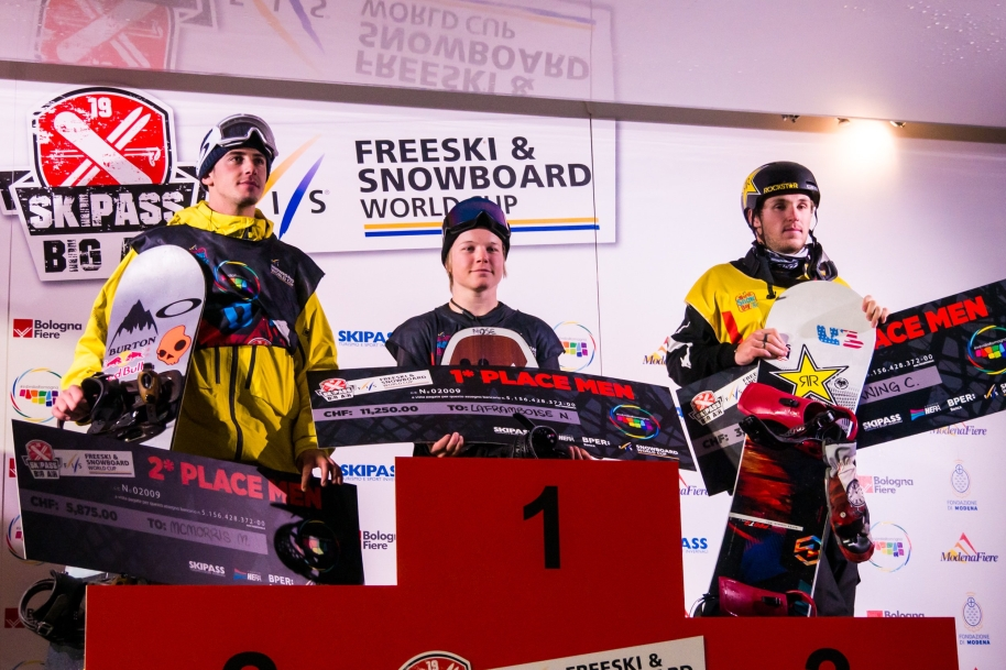 The winners of the snowboard world cup pose.