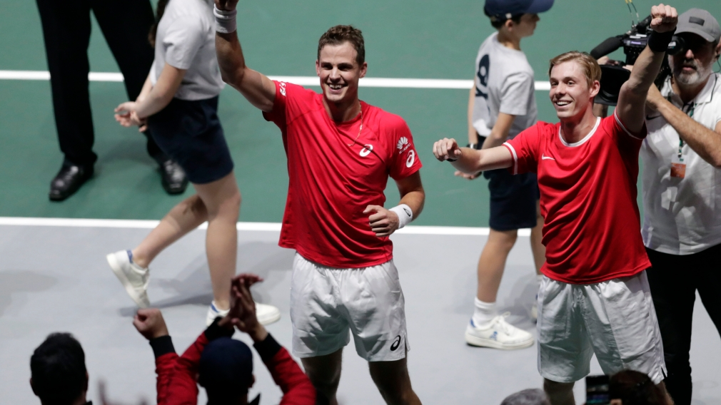 Denis Shapovalov, right, and his partner Vasek Pospisil celebrate after winning their Davis Cup semifinal doubles match